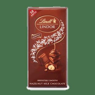 Lindt LINDOR Singles tejcsokoládé kockák mogyoródarabokkal és lágyan olvadó töltelékkel 100g