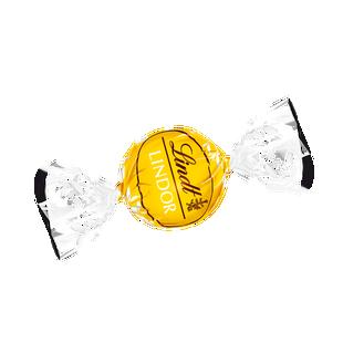 LINDOR fehércsokoládé lágyan olvadó mangós-tejszínes töltelékkel